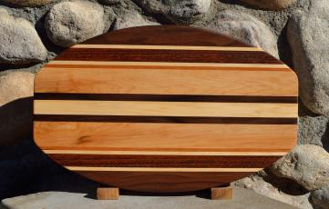 "Surfboard # 15 - 40. Black Walnut, Jatoba, Cherry & Hard Maple. 12"" x 19"" x 1-1/4""."