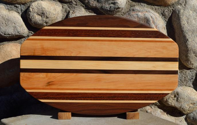"Surfboard # 15 - 40. Black Walnut, Jatoba, Cherry & Hard Maple. 12"" x 19"" x 1-1/4""."