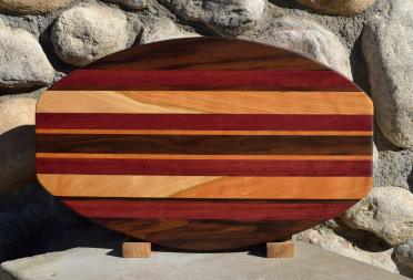 "Surfboard # 15 - 43. Black Walnut, Purpleheart & Curly Cherry. 12"" x 19"" x 1-1/4""."