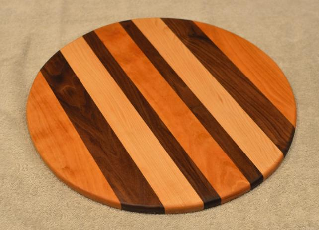 "Lazy Susan # 15 - 039. Cherry, Black Walnut, & Hard Maple. 17"" diameter x 3/4""."