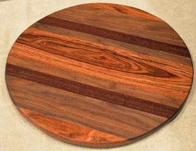 "Lazy Susan # 15 - 040. Jatoba, Black Walnut, Jarrah & Caribbean Rosewood. 17"" diameter x 3/4""."