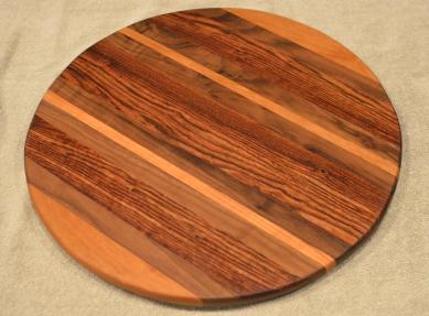 "Lazy Susan # 15 - 042. Cherry, Black Walnut & Caribbean Rosewood. 17"" diameter x 3/4""."
