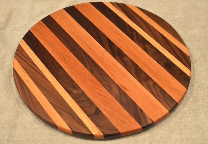 "Lazy Susan # 15 - 047. Black Walnut, Cherry & Honey Locust. 17"" diameter x 3/4""."