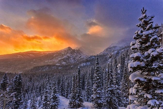 """Eric Schuette loves taking photos of Rocky Mountain National Park in Colorado. Every trip into the park can be a special moment. """"The mountains were completely covered by clouds. As we hiked into the darkness you could see little signs of clearing and then just before the sun came up the clouds thinned and we were left with a beautiful winter scene looking out towards Long's Peak."""" Photo by Eric Schuette. Posted on Tumblr by the US Department of the Interior, 12/21/15."""