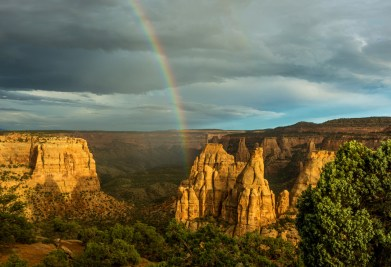 Colorado National Monument preserves one of the grand landscapes of the American West. It preserves towering monoliths within a vast plateau and canyon panorama. Magnificent views from highland trails and the Rim Rock Drive stretch from the colorful sheer-walled canyons and fascinating rock sculptures to the distant Colorado River valley. You might even see a pot of gold at the end of the rainbow. Photo by Amy Hudechek. Posted on Tumblr by the US Department of the Interior, 1/3/16.