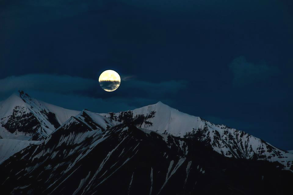 A full moon shines down on Denali National Park & Preserve in this photo taken from the Eielson Visitor Center. With six million acres of Alaska wilderness, massive glaciers and snow-capped mountains, imagine what more you could see after leaving the parking lot. Photo by Lian Law, National Park Service. Posted on Tumblr by the US Department of the Interior, 1/12/16.