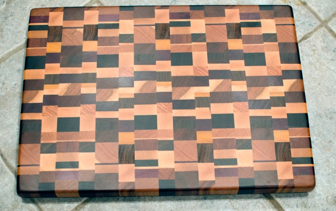 "Cutting Board 16 - End 010. Chaos board. Jatoba, Cherry, Padauk, Black Walnut, Honey Locust, Purpleheart, Yellowheart, Canarywood & Burmese Teak. End grain. 15"" x 20"" x 1-3/8""."