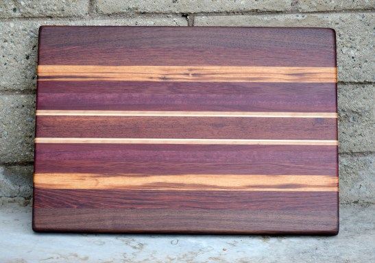 "Cutting Board 16 - Edge 004. Black Walnut, Padauk, Goncalo Alves, Jatoba, Purpleheart, Bloodwood, Hard Maple & Cherry. 16"" x 23"" x 1-1/2""."