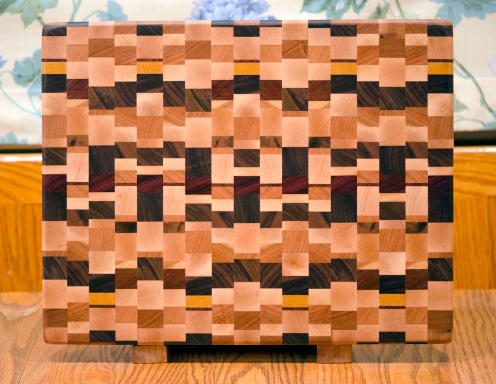 "Cutting Board 16 - End 023. Chaos Board. Hard Maple, Black Walnut, Cherry, Padauk, Jatoba, Yellowheart & Purpleheart. End grain. 14"" x 17"" x 1-1/4""."