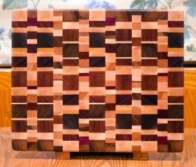 "Cutting Board 16 - End 024. Chaos Board. Purpleheart, Black Walnut, Hard Maple, Cherry, Yellowheart, Jatoba & Padauk. End grain. 14"" x 17"" x 1-3/8""."