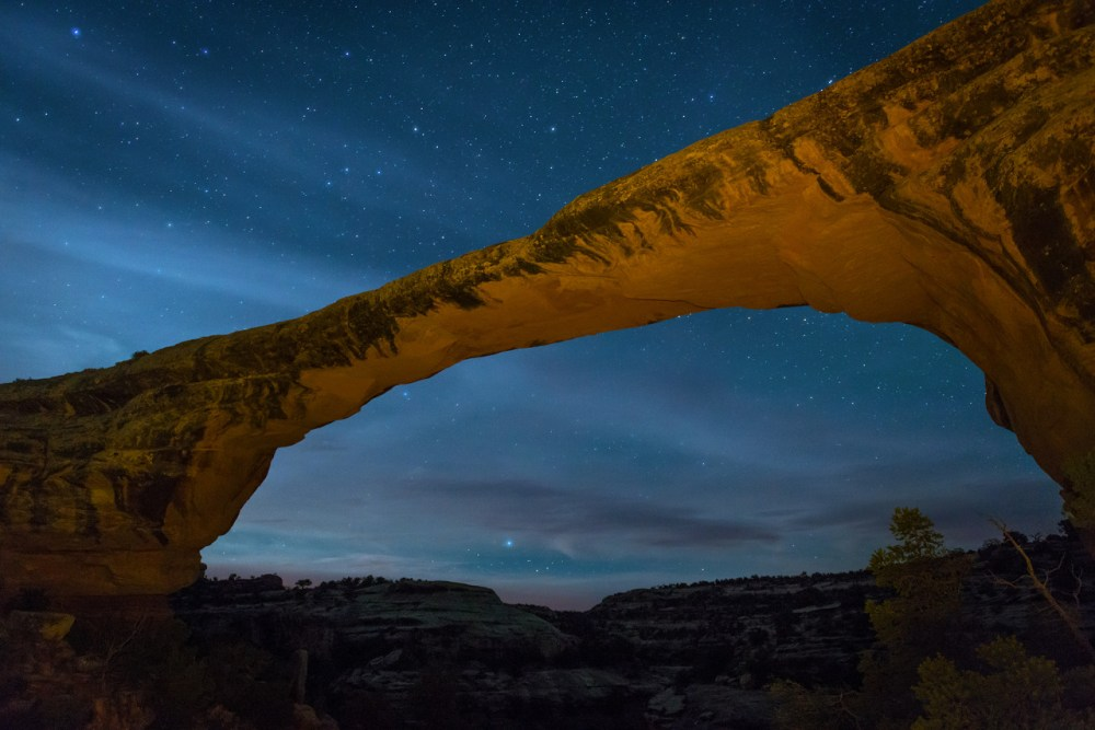 Wispy clouds and a star-filled night sky make for a dreamy backdrop to Owachomo Bridge at Natural Bridges National Monument in Utah. Home to some of the darkest skies in the country, Natural Bridges is a stargazer's paradise and was designated the world's first International Dark Sky Park. On a given night, it's possible to see up to 15,000 stars! Photo by Ryan McGinley. Posted on Tumblr by the US Department of the Interior, 3/9/16.