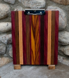 "Clipboard 16 - 009. Black Walnut, Canarywood, Honey Locust & Purpleheart. Letter size. 1/2"" capacity clip."