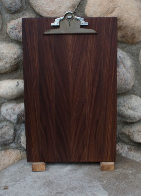 "Clipboard 16 - 012. Black Walnut. Legal size. 1"" capacity clip."