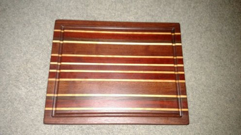 "Cutting Board 16 - Edge 007. Edge grain, Juice groove. Commissioned piece. Jatoba, Hard Maple, Padauk, Black Walnut & Bloodwood. 14-1/2"" x 18"" x 1-1/2""."