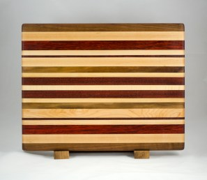 "Cutting Board 16 - Edge 009. Black Walnut, Hard Maple, Padauk & Bloodwood. Edge grain. 13"" x 17"" x 1-1/4""."