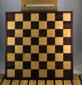 """Chess 16 - 03. Black Walnut & Hard Maple playing surface framed in Purpleheart. Squares are 2-1/8"""" across."""
