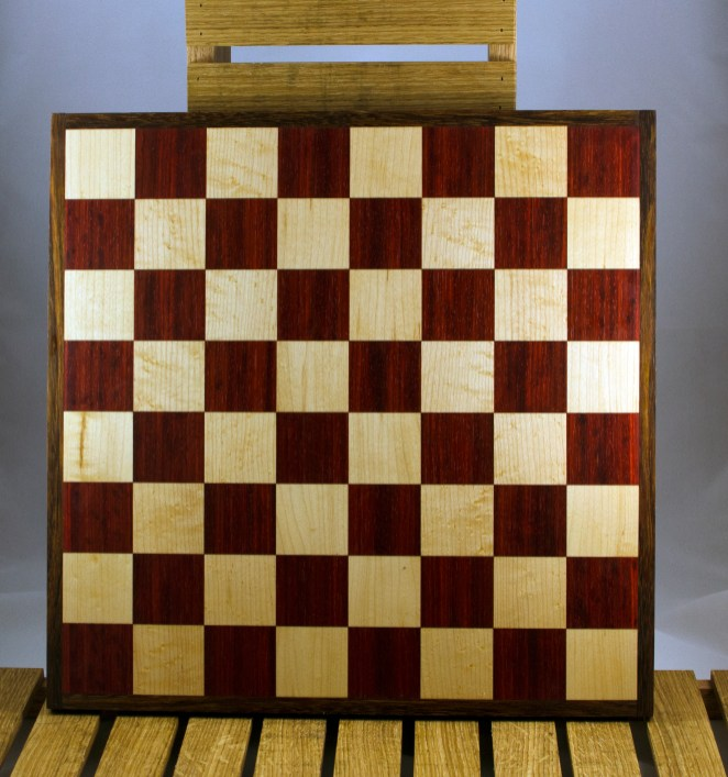 """Chess 16 - 05. Padauk & Hard Maple playing surface framed in Black Walnut. Squares are 2-1/8"""" across."""