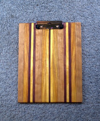 """Clipboard 16 - 013. Cherry, Canarywood, Yellowheart & Purpleheart. 1/2"""" clip, letter size."""