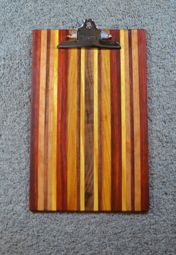 "Clipboard 16 - 015. Padauk, Red Oak, Yellowheart, Cherry & Canarywood. Legal size, 1"" clip."