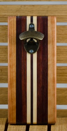 "Magic Bottle Opener 16 - 017. Wall mount. Cherry, Bloodwood, Bubinga & Hard Maple. Approximately 5"" x 10"" x 3/4""."
