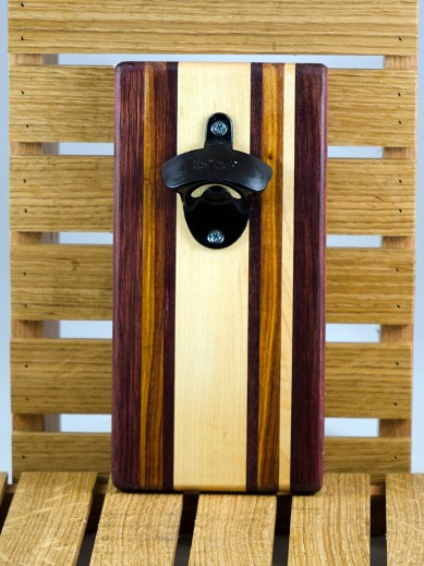 """Magic Bottle Opener 16 - 076. Purpleheart, Canarywood & Hard Maple. Double magic, so it will mount to your attractive refrigerator. Approximately 5"""" x 11"""" x 3/4""""."""