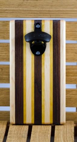 "Magic Bottle Opener 16 - 080. Wall mount. Hard Maple, Black Walnut & Yellowheart. Approximately 5"" x 9"" x 3/4""."