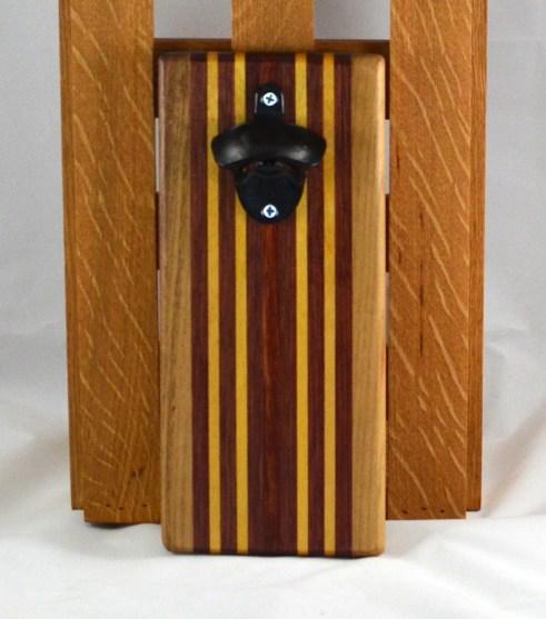Magic Bottle Opener 16 - 089. Black Walnut, Bubinga & Yellowheart. Wall mount.