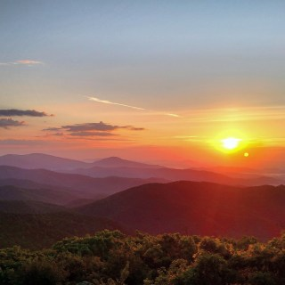 """Spectacular sunrises are a fantastic way to start an adventure in Shenandoah National Park in Virginia. Photographer Elliott Cliborne captured this brilliant photo at the top of Mary's Rock, where a 3.7-round trip hike along the Appalachian Trail leads to expansive views. Of the experience, says Cliborne: """"It was by far the best sunrise I experienced in over 400 miles of hiking last summer."""" Photo courtesy of Elliott Cliborne. Posted on Tumblr by the US Department of the Interior, 6/21/16."""