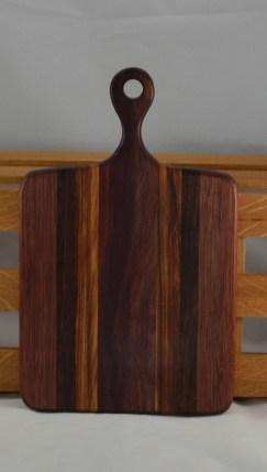 "Sous Chef 16 - 019. Bubinga, Canarywood, Purpleheart & Bloodwood. 9"" x 16"" x 3/4""."