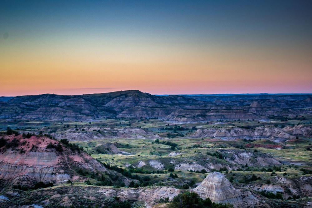 Theodore Roosevelt National Park in North Dakota honors President Theodore Roosevelt's conservation legacy. Visitors can see Roosevelt's Elkhorn Ranch Site, where he spent the bulk of his time and where many of his conservation ideas grew. In the spirit of Roosevelt's outdoorsy nature, the park also offers plenty of opportunities to explore through hiking, kayaking, biking, camping and more. Sunset shot of Painted Canyon Overlook courtesy of Robert Gjestvang. Posted on Tumblr by the US Department of the Interior, 7/12/16.