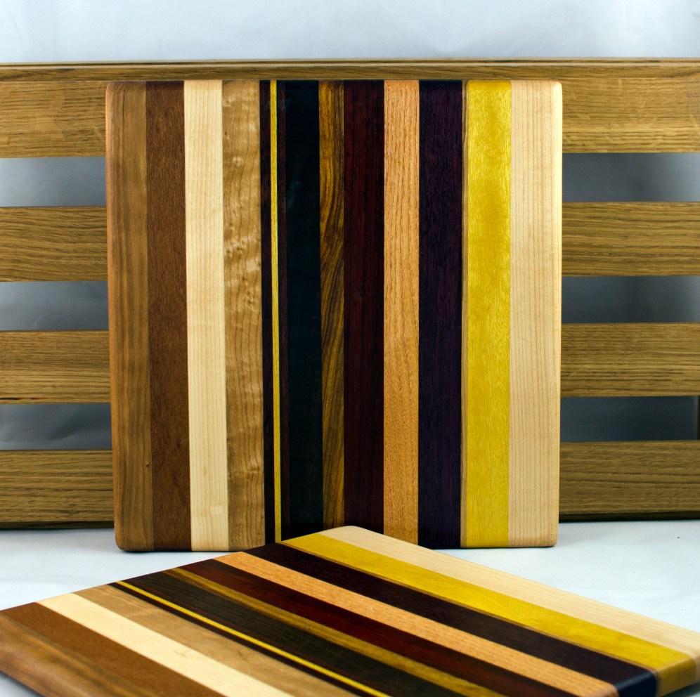 """Cheese Board 16 - 038. Jatoba, Cherry, Hard Maple, Yellowheart, Honey Locust, Padauk, Bloodwood & Black Walnut. 10"""" x 10"""" x 3/4""""."""