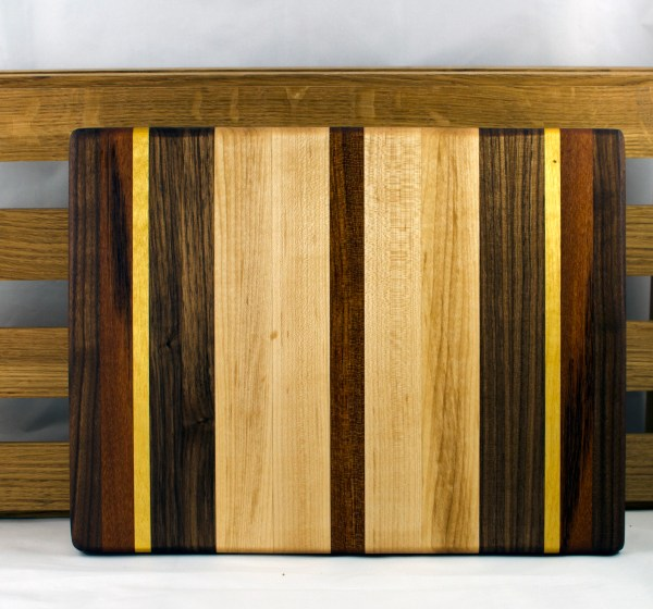 "Small Board 16 - 019. Black Walnut, Goncalo Alves, Yellowheart, Hard Maple & Jatoba. 10"" x 12"" x 1"". This board was the victim of a warped board that didn't glue up flat enough to smooth ... so I had to cut out that board & its neighbors, add new boards, and re-glue."