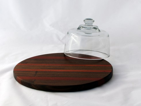 This is the flat side, which could be used for serving or a cutting board. The flip side has the routed circle to hold the dome in place.