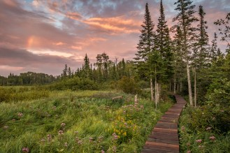 "Walk in the footsteps of fur traders and the Grand Portage Ojibwe at Grand Portage National Monument, located on the North Shore of Lake Superior in Minnesota next to the Canadian border. The 8.5-mile Grand Portage Trail winds through history and beautiful scenery like forests and meadows. After hiking through a downpour, photographer Travis Novitsky says, ""The gorgeous sunset over the beaver meadow made it all worthwhile!"" Photo courtesy of Travis Novitsky. Posted on Tumblr by the US Department of the Interior, 9/1/16."