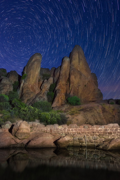 Swirling star trails grace the night sky at Pinnacles National Park in California, the nation's 59th and newest national park. 23 million years ago, volcanoes erupted, flowed and slid to form the park's towering rock spires and rare talus caves that you can hike through today. Photographer Aron Cooperman journeyed 45 minutes through a cave to reach Bear Gulch Reservoir in time to capture this spellbinding scene. Photo by Aron Cooperman. Posted on Tumblr by the US Department of the Interior, 9/9/16.