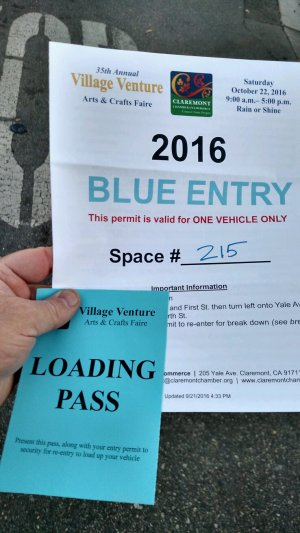 The large sheet was the original entry pass for the morning; you had to have both it and the blue loading pass (for the blue zone) in order to bring your car in for loading.