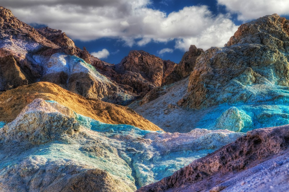 No need to adjust your screen, this technicolor terrain is Artist's Pallette at Death Valley National Park in California. Aprons of blue, pink, green, purple, brown and black drape across the mountain front. Metals and minerals affected by oxidation and other chemical reactions created this unique landscape. Photo by Kevin O'Connell. Posted on Tumblr by the US Department of the Interior, 10/6/16.