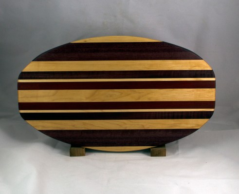 "Cheese & Cracker Server 16 -07. Hard Maple, Purpleheart, Bloodwood & Bubinga. 12"" x 19"" x 1-1/4""."