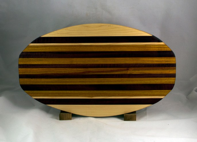 "Cheese & Cracker Server 16 - 12. Hard Maple, Purpleheart & Canarywood. 12"" x 19"" x 1-1/4""."