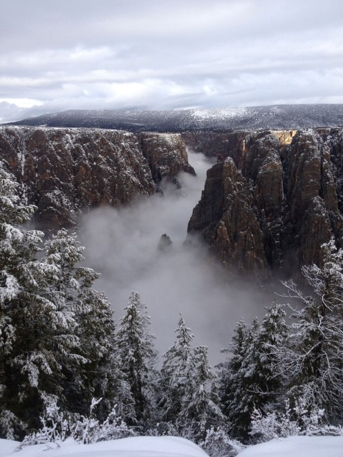 Big enough to be overwhelming, still intimate enough to feel the pulse of time, Black Canyon of the Gunnison exposes you to some of the steepest cliffs, oldest rock and craggiest spires in North America. This western Colorado landmark was sculpted by the Gunnison River and the forces of weather over 2 million years. Photo of a snowy and fog-filled canyon by Judd Clark, National Park Service. Posted on Tumblr by the US Department of the Interior, 12/1/16.