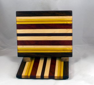 """Cheese Board 16 - 062. Black Walnut, Hard Maple, Yellowheart, Cherry & Padauk. 8"""" x 11"""" x 3/4""""."""