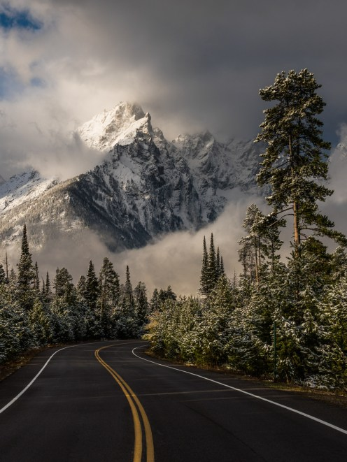Morning greets Grand Teton National Park in Wyoming with curling clouds and snow-dusted peaks. When photographer Eric Adams noticed the weather clearing through airport windows, he rebooked his flight, rented a car and drove along the park's Jenny Lake Road to capture this stunning scene. Photo by Eric Adams. Posted on Tumblr by the US Department of the Interior, 11/28/16.