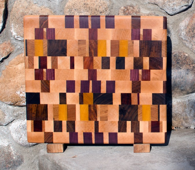 "Cutting Board 17 - 404. Chaos Board. Hard Maple, Cherry, Jatoba, Purpleheart, Yellowheart, Goncalo Alves & Hickory. Edge Grain. 12"" x 12"" x 1-1/4""."