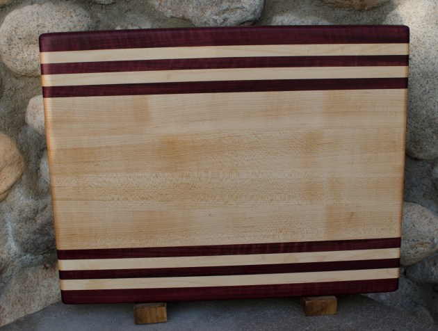 "Engraved 16 - 42. Purpleheart & Hard Maple. Edge grain. 12"" x 16"" x 1-1/4""."