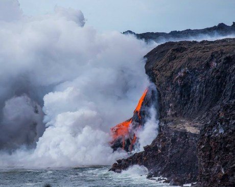 """In January, a 22-acre section of a lava delta in Hawaii Volcanoes National Park broke apart and sank into the ocean causing the closing of a viewing area. Now, from the new viewing area, visitors can witness a """"fire hose"""" of lava streaming into the ocean. The molten rock sends huge clouds of steam and gas into the air as it hits the Pacific. It's a sight you'll never forget. Photos by National Park Service. Posted on Tumblr by the US Department of the Interior, 1/13/17."""