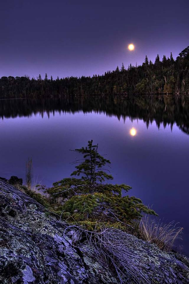Located in the northwest corner of Lake Superior, Michigan's Isle Royale National Park is the place to go for solitude. The park is an island of roadless backcountry reachable only by boat or seaplane – making it the least visited national park in the lower 48 states. Photographer Carl TerHaar captured this moonrise from Pickerel Cove, one of the islands' campgrounds that consists of a narrow ridge accessible by small boat. Full moon photo by Carl TerHaar. Posted on Tumblr by the US Department of the Interior, 12/8/16.