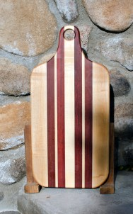 """Bread Board 17 - 501. Hard Maple & Bloodwood. This is an undersized bread board; most are 20"""" long. Since this has a handle, it's not really a small board. According to me! 8"""" x 16"""" x 1""""."""