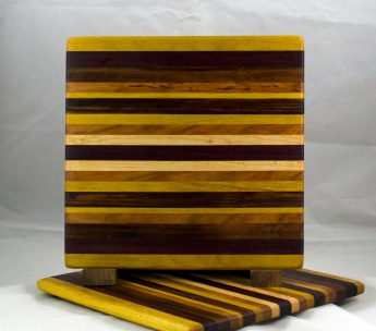 "Cheese Board 17 - 316. Yellowheart, Goncalo Alves, Hard Maple, Cherry & Purpleheart. 11-1/2"" x 11-1/4"" x 1/2""."