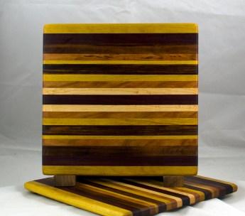 "Cheese Board 17 - 316. Yellowheart, Goncalo Alves, Hard Maple, Cherry & Purpleheart. 11-1/2"" x 11-1/4"" x 1/2""."