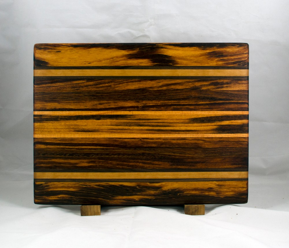 "Cutting Board 17 - 108. Goncalo Alves, Black Walnut, Honey Locust, Jatoba & Cherry. Edge Grain. 11"" x 17"" x 1""."